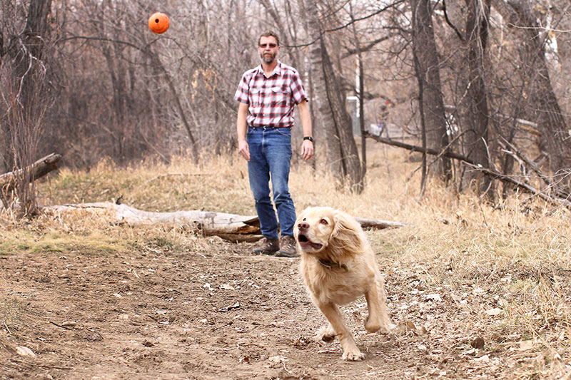 Wade L. Clements enjoys a day with his dog Diesel. Because his employer partners with UCHealth for occupational health services, Wade's heart murmur was found before something serious happened to him.