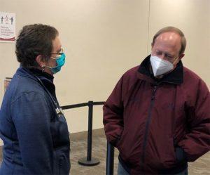 Carolyn Carroll Flynn talks to Colorado Springs Major John Suthers.