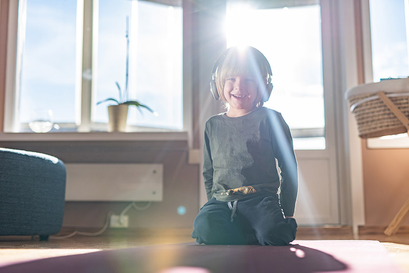 Child with headphones getting the benefits of music before bed