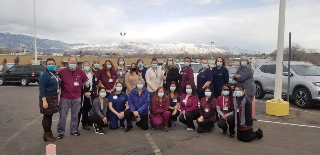 A team of caregivers who provide vaccines at UCHealth Memorial Administrative Center are photographed in parking lot outside the vaccine clinic in Colorado Springs..