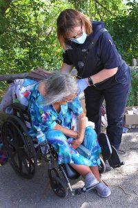 UCHealth Community Paramedics assist a woman who is in distress. Photo: Joel Blocker.