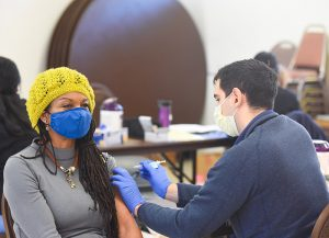 Side effects for COVID-19 vaccines are normal. What to expect. Woman receives her vaccine at a vaccination clinic in Denver.