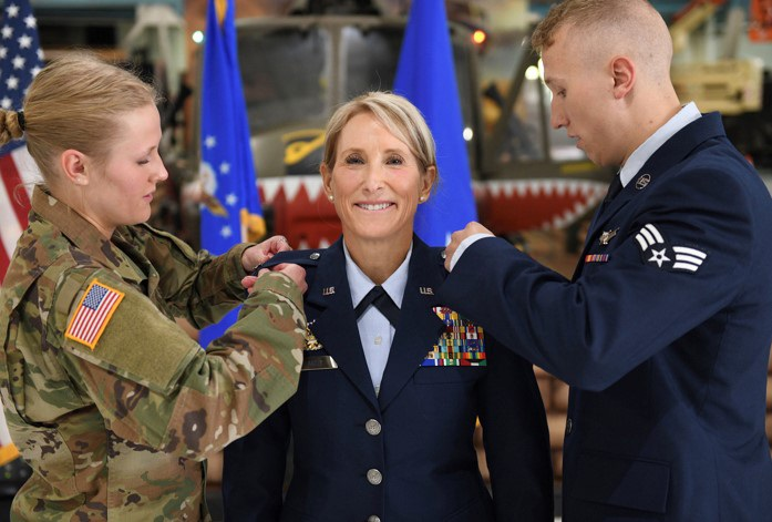 Cadet Tori Flarity and Senior Airman Patrick Flarity pin stars on their newly promoted mother, Brig. Gen. Kathleen Flarity, mobilization assistant to the command surgeon, Air Mobility Command. Farity discusses setting goals and how to achieve them.