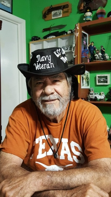 """losing family to loved ones. Among those who died: Ricardo Tellez. Here he wears a hat that says """"Navy Veteran."""""""