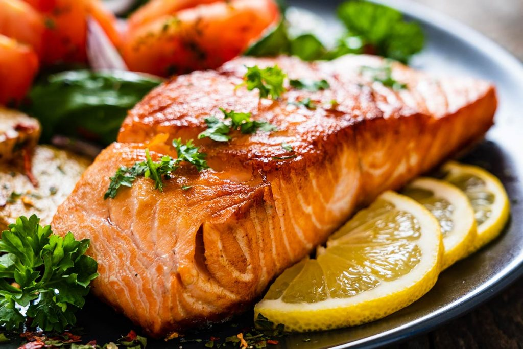 A colorful picture of a plate of salmon.