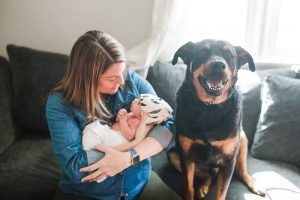 Should pregnant women get COVID-19 vaccines? Here, Dr. Anna Euser poses with her newborn daughter, Nell, and her dog, Dutch.