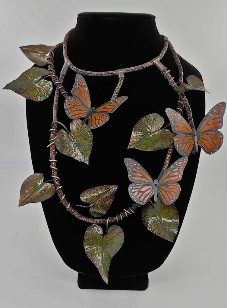 metal art piece with butterflies