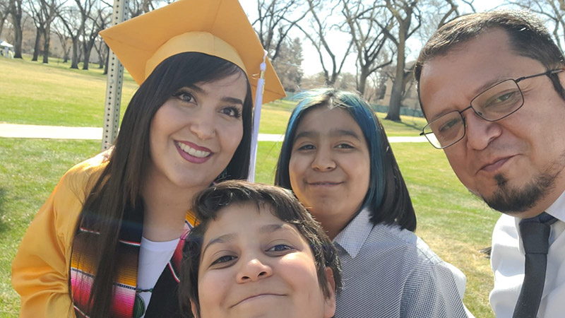 Priscilla Gonzalez with her family at her CSU graduation.