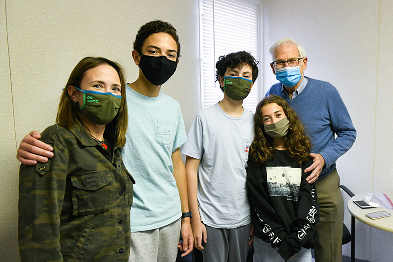 kids and clinical trials for COVID-19 vaccines. The Vannoni kids pose with their mom and Dr. Myron Levin.