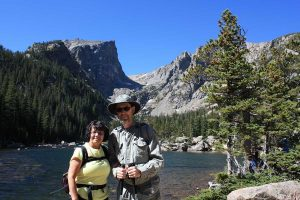 : Dennis Mullen and wife Nancy enjoy a day at Dream Lake in Rocky Mountain National Park. Mullen was diagnosed with Parkinson's disease in 2010. Photo courtesy of Dennis Mullen.