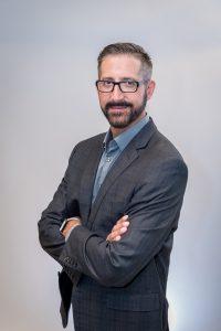 Dr. Alex Constantinides
