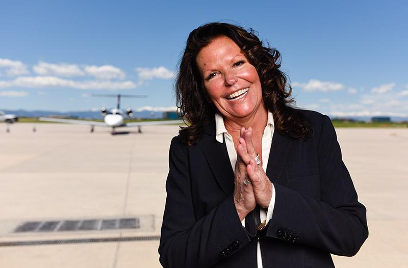 Gail Sadler, a lung cancer patient, outside Modern Aviation at Centennial Airport.