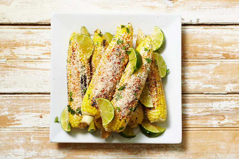 Elotes(Grilled Mexican street corn) using fresh corn.