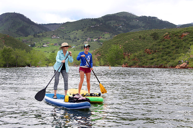 Friends Maryann Goyn, left, and Alison Holloran, take to their paddleboards for some girl time at Horsetooth Reservoir. Photo by Joel Blocker, for UCHealth.