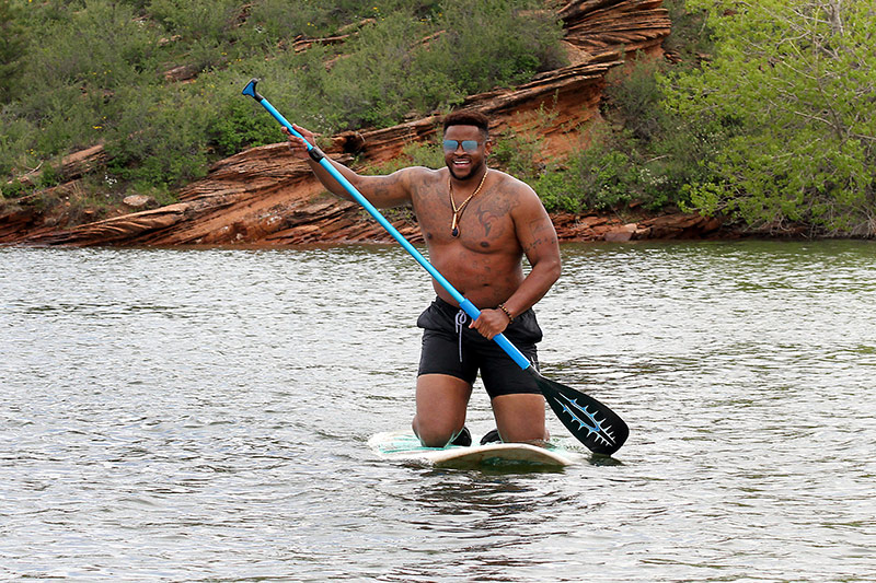 Nathaniel Mills, of F.E. Warren Air Force Base in Cheyenne, Wyoming, visited Horsetooth Reservoir recently to paddleboard. Photo by Joel Blocker, for UCHealth.