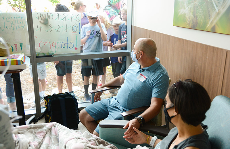 Cathy Pane finished up chemotherapy for small bowel cancer as family and friends gathered outside to help her celebrate.