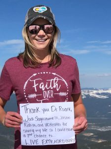 A year to the day after her stroke, Hannah sent this mountaintop message to UCHealth neurosurgeon Dr. Christopher Roark and colleagues. Photo courtesy of Hannah Holt.