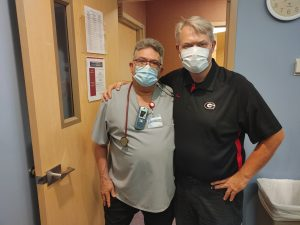 Lance James, right, poses for a picture with his former respiratory therapist Kevin Londrigan, while visiting the MCR CICU recently to say thanks to his caregivers for saving his life two years prior. Photo by Kati Blocker, UCHealth.