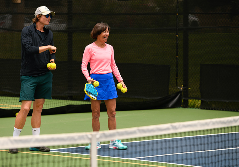 What is pickleball? A woman learns how to play pickleball with a pro at Gates Tennis Cener in Denver.