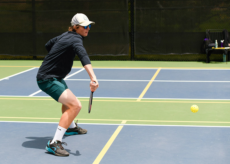 What is pickleball? Robert Leonard shows how to hit the ball during a pickleball class.