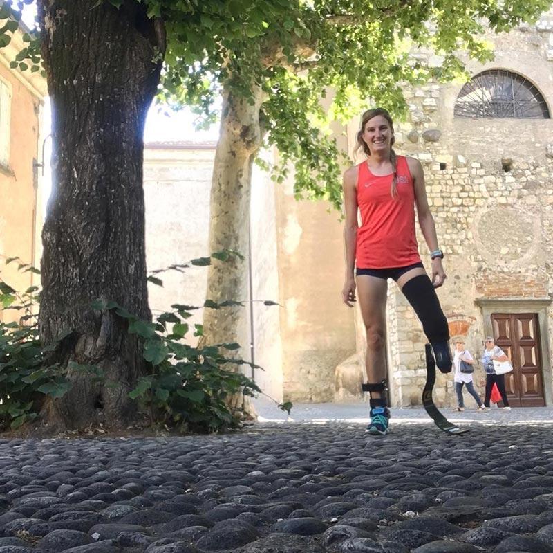 Allysa Seely poses on a cobblestone street.