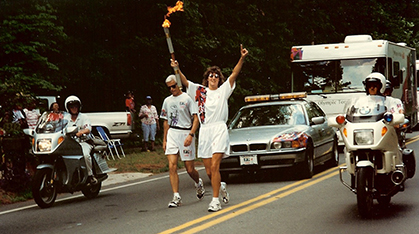 Olympian Laura Ryan carries the torch.