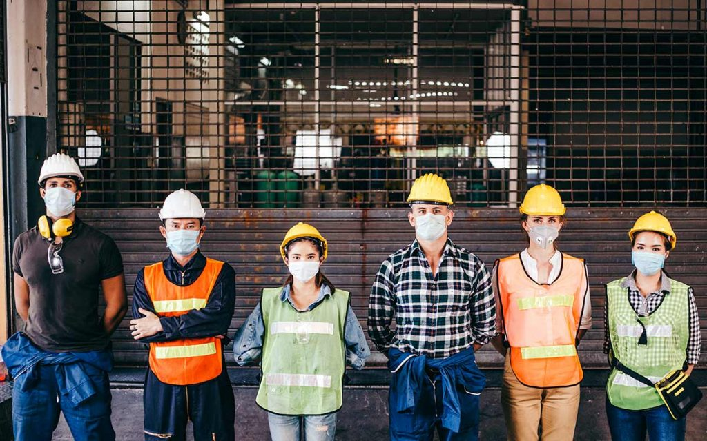 workers in hard hats wearing masks