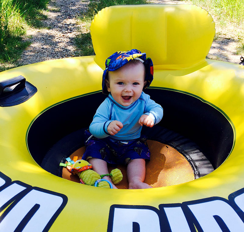 Creativity and safety surround most tips for camping with kids. Like this inner tube, which is great for when your camp is by water, but can also be used as a clean playpen on shore.