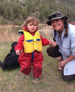 Lifejackets are always important when camping or playing by water, but this child's full-body rainsuit allows him to keep dry and enjoy the outdoors when the sun is not shining.