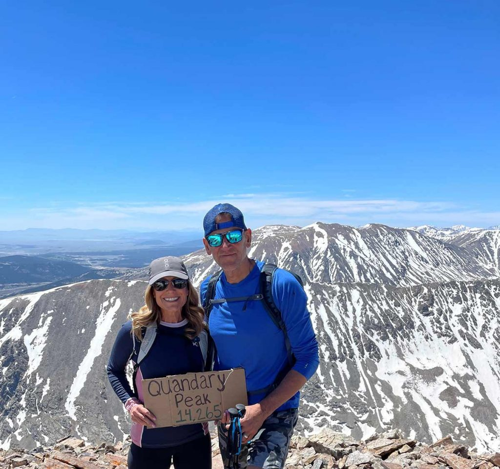 Laurel Komarny and her husband are photographed at the top of Quandary Peak.