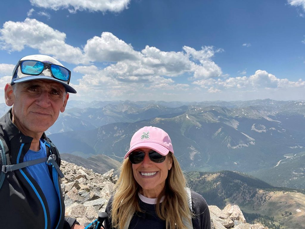 A couple reaches the summit of one of Colorado's 14ers.