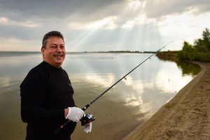 Man, who will get a third dose of COVID-19 vaccine because he had a transplant, now enjoying fishing.