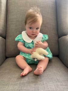 Juliana with one of her favorite stuffed animals.
