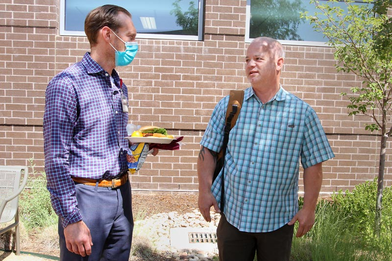 John Larson, right, Jacob's father, talks with Dr. Robert Janata, pulmonologist and critical care physician.