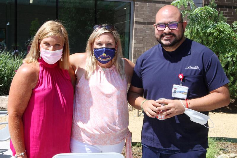 From left, Jacob Larson's mom, Lynn Braun, his aunt, Sarah Braun, and Fernando Mijares, associate nurse manager of Longs Peak Hospital medical/surgical unit. Photo by Joel Blocker, for UCHealth.