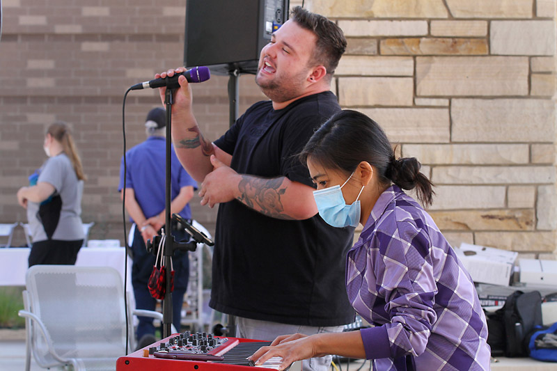 Soul and funk singer Jacob Larson, accompanied by pianist Olivia Rebolledo, sing for health care workers at Longs Peak Hospital in late August.