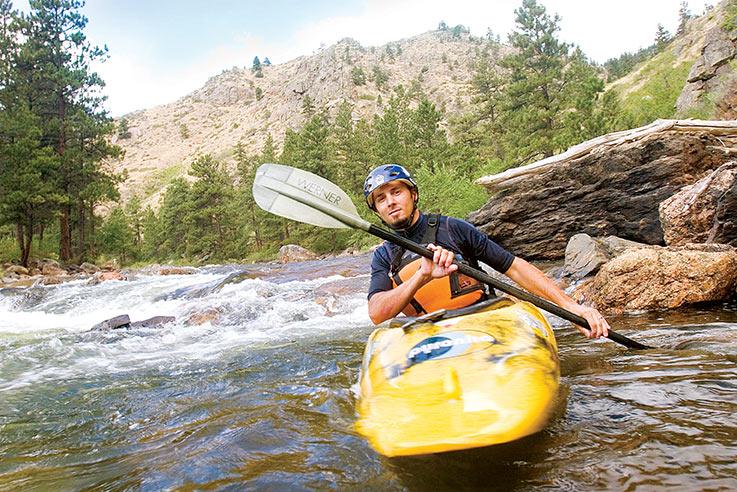 A kayaker on the Cache La Poudre River