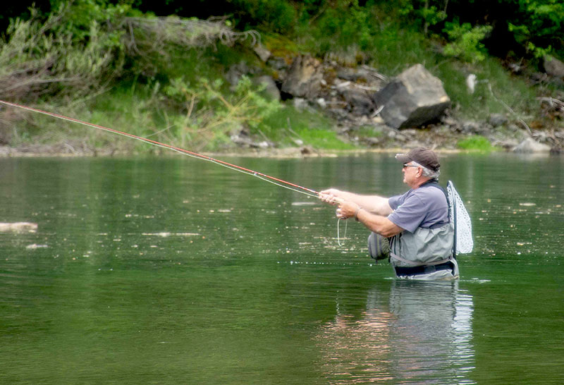 Mike Oster enjoying his retirement and fishing after his robotic thymectomy that alleviated his symptoms of myasthenia gravis. Photo courtesy of Mike Oster.