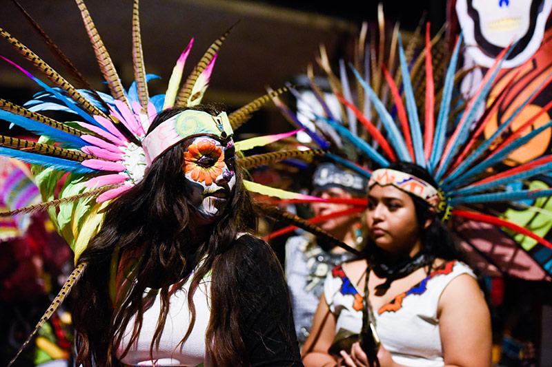 Indigenous dancers celebrate Day of the Dead or Día de los Muertos
